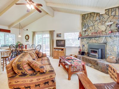 Photo for Cozy home in the woods w/ deck, shared pool, tennis - near golf & lake