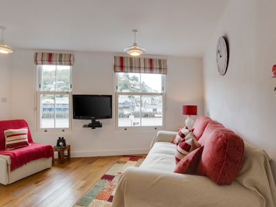 Photo for Cosy apartment with a great view of the harbour and the sea