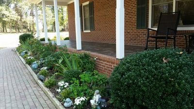 View of front walkway and fall flowers and partial view of  480 sf front porch