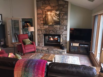 Two way gas fireplace with remote - 50 inch smart tv