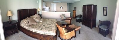 Panoramic View of condo living area with full kitchen & washer/dryer.