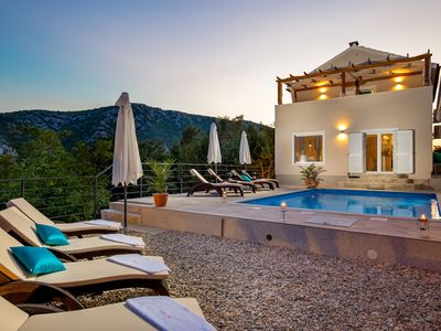 Photo for Villa on a hill with sea views and heated pool