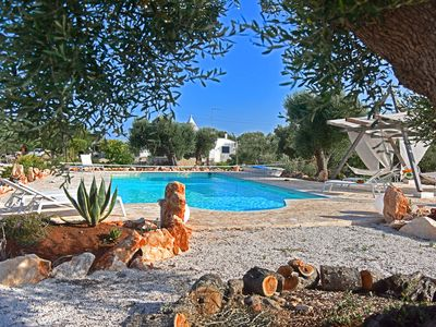 Photo for Magnificent Trullo with salt water pool set in an ancient olive groves