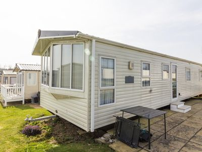 Photo for 8 berth dog friendly caravan for hire at Haven Hopton in Norfolk ref 80005F