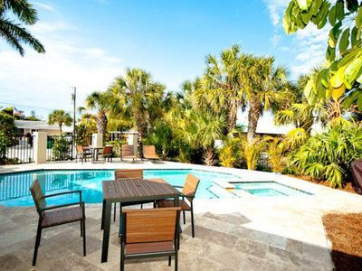 Photo for Canalside home with dock and pool - blocks to the beach & free trolley!