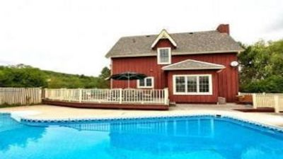 Photo for Family Friendly Cottage.Heated Pool opens May 17th & hot tub. Book Summer 19 NOW