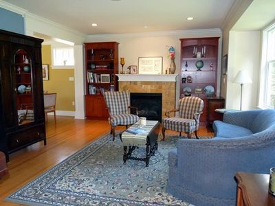 Warm Living Room to enjoy visiting with friends and family, including a piano.