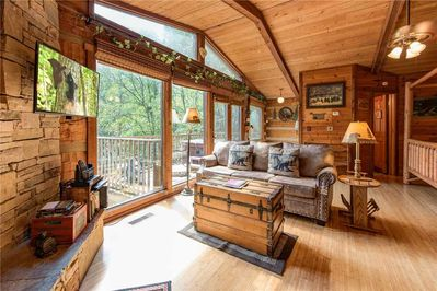 A perfect name for a perfect cabin - Wood-planked walls, ceilings, and floors; a stone-surround gas fireplace; stunning Smoky Mountain views; cozy, classic furnishings: Pet-friendly Rustic Charm has everything you need for an idyllic getaway.