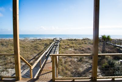 Boardwalk to beach is shared by you and a smaller rental unit on first floor