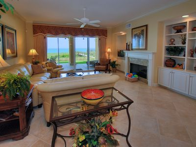 living room overlooking ocean.EXPANSIVE VIEW OF OCEAN FROM KITCHEN,DINING & LR.