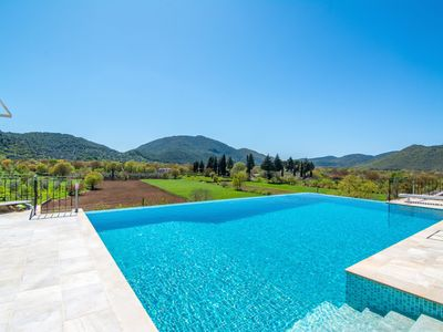 Photo for Renovated Farmhouse With huge superb Infinity Pool And Views