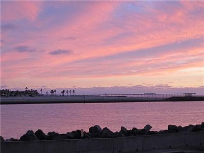 View from our front door, sunset over the Jetty and Ocean Beach Pier