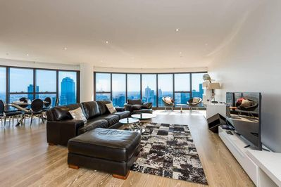 A luxurious and spacious living area with a panoramic view of Melbourne's amazin