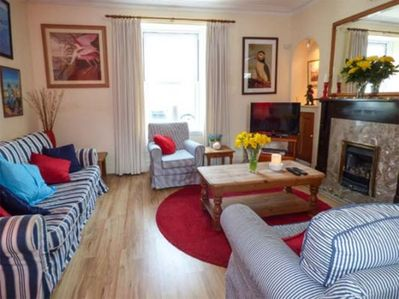 Sitting Room with Window  to street and gas fire. Bright and Airy.