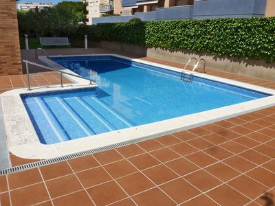 Photo for AT042 PLATJA: Apartment with pool 100 m from the beach