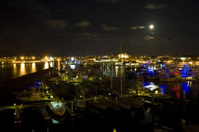 View of marina at night from balcony of building D