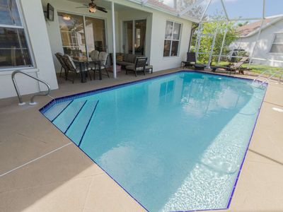 Photo for Briarwood Home-Screened Pool, Outdoor Seating w/TV, Dining Area & Grill all w/Incredible Lake Views!
