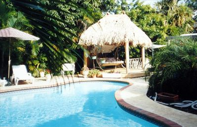 Very private pool area with mature landscaping, 2 tier deck, barbecue,tiki hut.