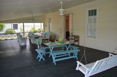 Screen Porch with Picnic Table and Swing