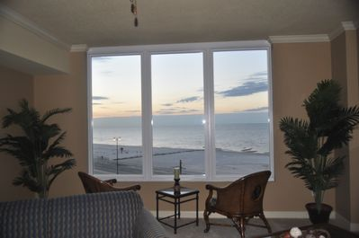 Sitting area by large picture window overlooking the gulf