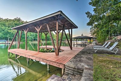 This home provides direct lake access, a dock, and a boat slip!