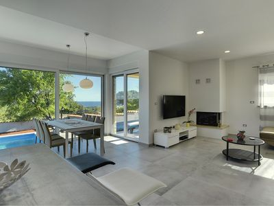 Photo for Fantastic new villa with private pool, climate, WiFi in a sauna and beautiful sea views