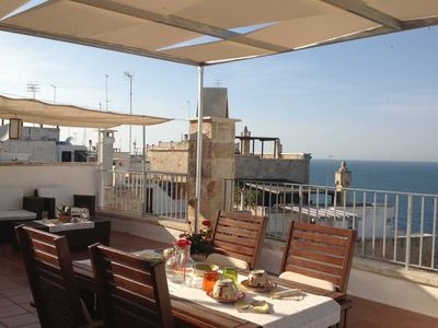 Photo for Delightful beachfront residence in the historic center of Polignano