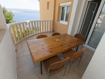 Photo for Two bedroom apartment with terrace and sea view Zavode, Omiš (A-11861-b)