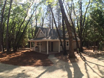 Photo for Beautiful new cottage, nestled in the woods, just 2 miles from downtown