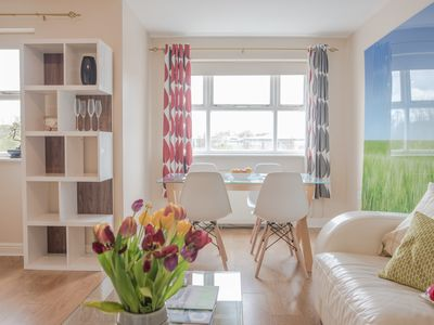 Photo for 2-bed modern flat near train station, free parking & bikes, sleeps up to 6