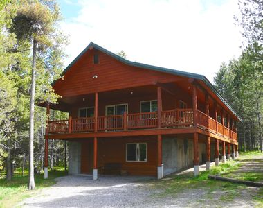 Eagle's Nest , a large 2-story cabin with wrap-around deck and plenty of parking