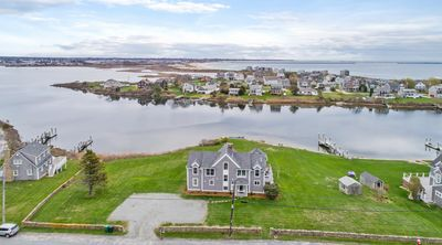 Photo for Modern New Waterfront home! Panoramic Deck. Walk to beach!