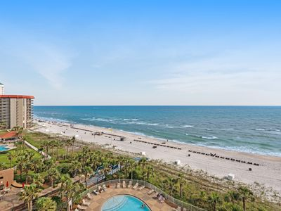Photo for Beachfront condo w/ balcony, Gulf view & shared pool/hot tub/gym!