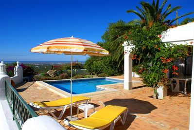 Pool deck and panoramic sea views of coastline and offshore islands