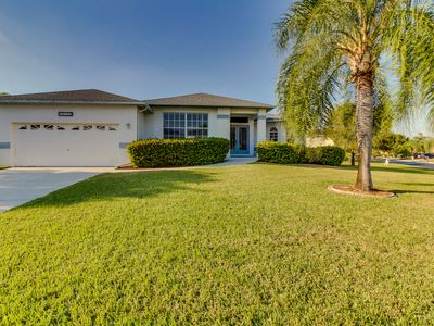 Photo for Breezy home w/ lush views, a screened-in pool, close to the beach!