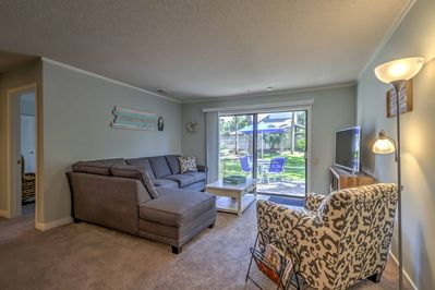 Open the sliding glass doors in the living room and relish the fresh air.