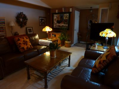 The living room features a large screen T.V. as well as comfortable seating.