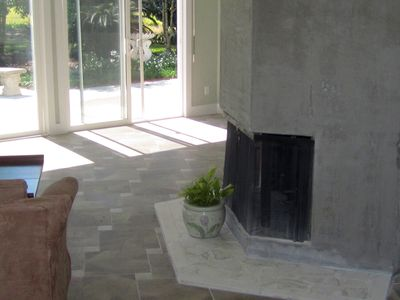 The open concept floorplan has rooms that wrap a central 6-sided fireplace.