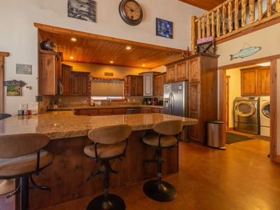Photo for Come get cozy around the wood burning fireplace in this large pet friendly cabin! Short distance to