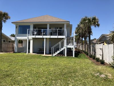Spacious back yard leading to the private boardwalk and ocean
