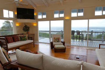 Enjoy panoramic ocean views while lounging in the spacious living room