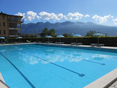 Photo for Apartment on Lake Garda with pool, tennis court and panoramic sea views