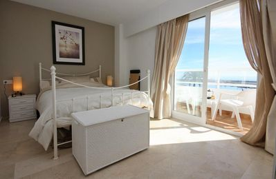 Master bedroom with en-suite bathroom and terrace with sea views