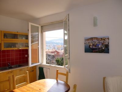 The upstairs kitchen area with view towards the port