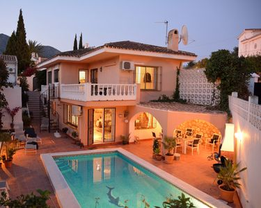 Photo for 4-bedroom villa with private heatable pool