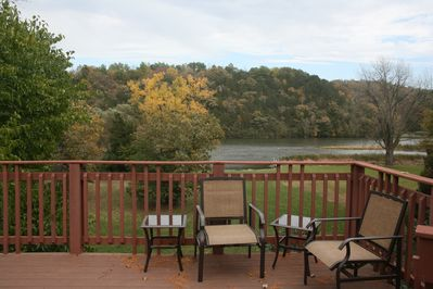 Deck overlooks large yard and waterfront.