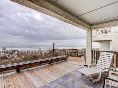 Photo for Lovely first floor condo w/ ocean views, patio, & grill - steps from the beach!