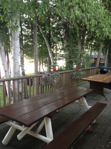 Huge deck with two picnic tables for outdoor dinners