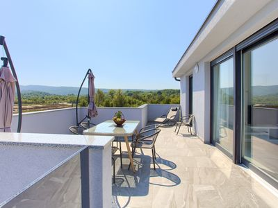 Photo for Holiday apartment with pool use and sea views from the roof terrace