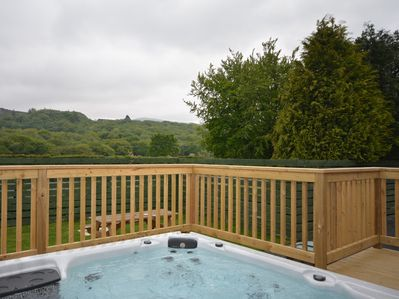 Enjoy the private hot tub during your stay